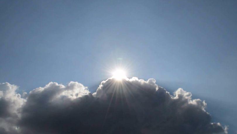 Солнце из-за туч
